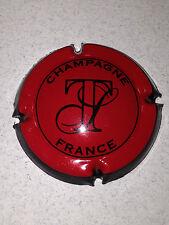 Capsule de champagne TRIBAUT (27a. fond rouge)