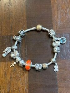 Authentic Pandora 14k gold lock 925 silver charm bracelet w/14 charms