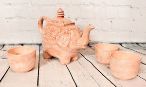 Vintage elephant teapot with cups