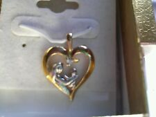 Mother and child heart pendant 14K Two tone gold, 2 grams, open design