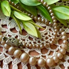 """Vtg Faux Pearls Strand Tapered Decorative Clasp Necklace. Circum 17 3/4"""". Tan."""