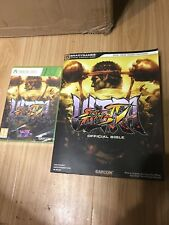 Ultra Street Fighter IV xbox 360 game and bilble book guide