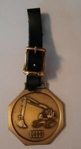 VINTAGE CASE EQUIPMENT EXCAVATOR WATCH FOB MEDALLION WITH BLACK LEATHER STRAP