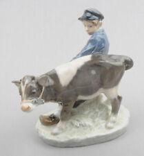 Royal Copenhagen (Denmark) Porcelain Figurine, Boy Walking Calf No.772