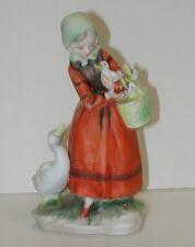 Porcelain figurine woman with geese