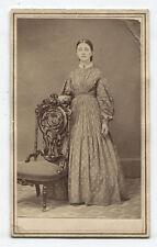 CDV CIVIL WAR ERA WOMAN STANDING AT ORNATE CHAIR.