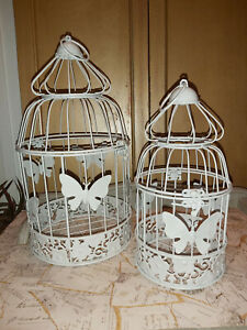 """SET OF """"TWO"""" WHITE IRON ORNAMENTAL BIRDCAGES IN A BUTTERFLY THEME"""