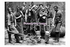 pu1795 - Sheffield - Crucible Steel Making, Men with their Tools - photograph