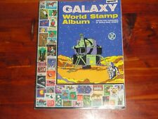 GALAXY WORLD STAMP ALBUM w/MANY STAMPS & FLAGS STAMPS OF MANY COUNTRIES