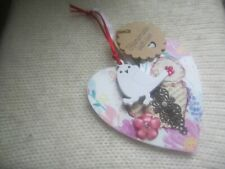 hanging wooden flower heart decoration with bird and flowers
