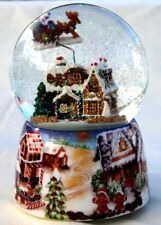 Musical Snow globe with ginger bread house in a snow storm