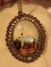 Swirl Rim Brasstone Acrobat on the Back of a Rhinoceros Pendant Necklace Brooch