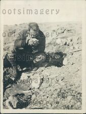 1934 Geologist Examines Ore Samples on Canada Arctic Coast Press Photo