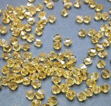 40 perles en verre à facettes toupies 4mm or transparent //3