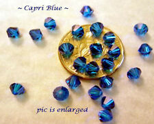 48 CAPRI BLUE SWAROVSKI CRYSTAL # 5301 BICONE BEADS 4MM