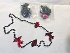 **NEW* 3 SETS OF FIREBALL WHISKY MARDI GRAS STYLE BEADS, BLACK BEADS RED CHARMS