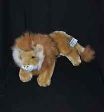 Peluche doudou lion LASCAR brun marron roux yeux durs 28 cm de long TTBE
