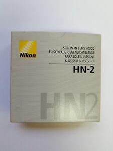 Original Nuevo Nikon HN-2 Parasol de rosca para objetivos Nikkor AF 28mm f/2.8 D