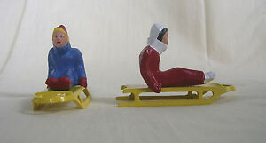 Seated Woman Sledder with sled, Christmas Village, train layout, Reproduction