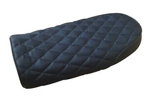 Cafe racer seat in black with chequered pattern finish and black piping flat