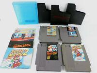 4 Different Mario Bros. NES Carts w/Manuals & Covers SMB, SMB2 SMB/DH, SMB/DH/TM