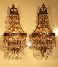 Pair of ornate cast brass and crystal sconces.