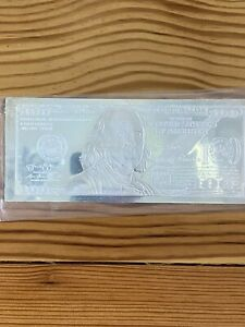 2014 4oz Silver Ben Franklin 100 Dollar bill in plastic case.