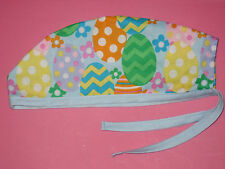 Surgical Scrub Hats caps Easter Big eggs and flowers on light blue