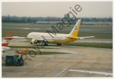 Colour print of Royal Brunei Boeing 767 33AER V8-RBG at Heathrow in 1997