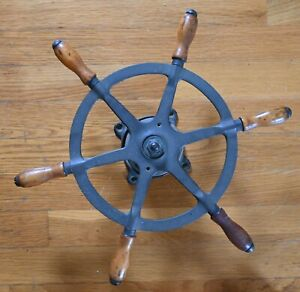 Antique brass ship's boat wheel with great patina.