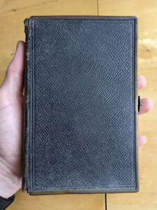 Small, leather bound Oxford Bible with brass edges and clasp (1876)