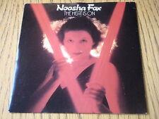 "NOOSHA FOX - THE HEAT IS ON   7"" VINYL PS"