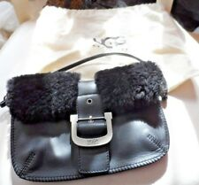 small black handbag with back shearling accents from UGG w/ dust cover