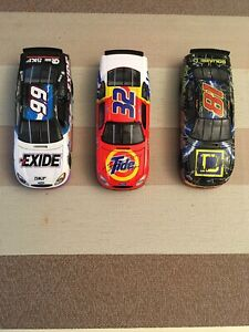 Three NASCAR 1/24 Diecast Cars. Wallace And Craven Signed