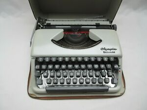 Vintage Olympia Splendid 66 portable typewriter & case