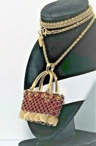 BETSEY JOHNSON  PENDANT GOLD & RED ENAMEL & MOON STONE PURSE A GOLD NECKLACE