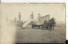 real photo postcard of ranchers at a barn house building with horse carriage