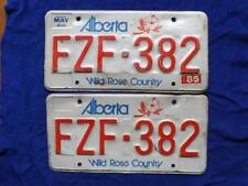 ALBERTA LICENSE PLATE 1985 FZF 382 SET PAIR CANADA MAN CAVE SIGN CAR SHOP