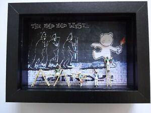 NOCH PAINTERS FIGURES WITH A BANKSY PRINT PRESENTED IN A BLACK FRAME