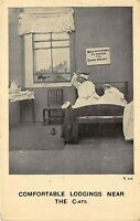 Comfortable Lodgings Near The Cats c1910 Comic Postcard Couple in Bed Cats