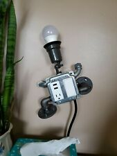 Wall Mounted Climbing Robot Lamp Charging Station.