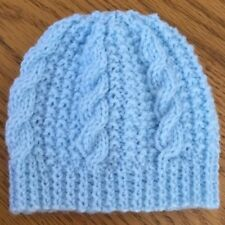 Hand knitted blue cable pattern newborn baby hat