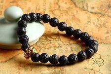 Élastique crâne doré pierre de lave bracelet / bracelet / 22cm / 8.5 pouces / 8mm perles