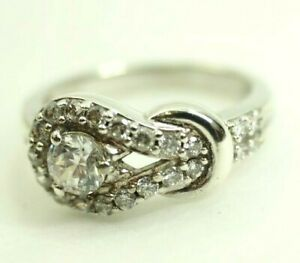 Ladies Knot Ring with 23 Cubic Zirconia Sterling Silver size 7
