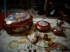 9 pieces red and gold limoges in excellent condition.