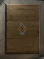 Piece of lakers floor board signed by kobe bryant, and the whole 2016 team.