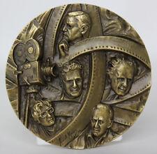 ART CINEMA Film Directors O WELLS FELLINI ROSSELLIN SERG EISENSTEIN Bronze Medal