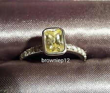 Emerald Bezel Solitaire in Fancy Yellow Ring - CARAT* London