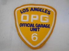 LOS ANGELES OPG OFFICIAL GARAGE UNIT 6  USED EMBROIDERED  SEW ON NAME PATCH TAG
