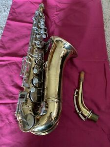 Vintage alto saxophone with case, accessories and Selmer mouthpiece.